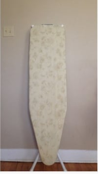 beige floral clothes ironing board
