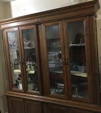 Brown wooden framed glass display cabinet Toronto, M9C 2Z4