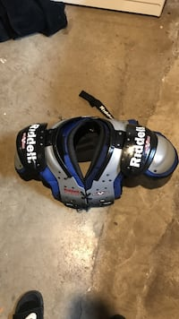 blue and black Riddell shoulder pads Burlington, L7T 4J5