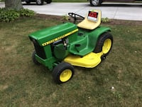 Green and yellow john deere ride on lawn mower Winfield, 60190