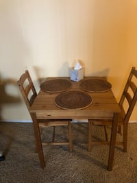 Brown wooden table with two chairs. Very good condition. Local pick up Cumberland/ Foster area Hickory Hills, 60457