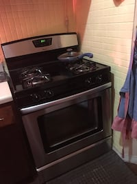 Black and silver gas range oven
