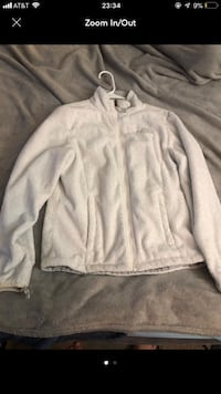 White fleece north face jacket with some blue tint to right sleeve  Henderson, 89015
