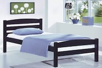 Brown wooden bed frame with mattress and gray bed sheet set