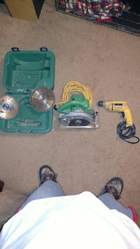 green circular saw with power drill and case King, 27021