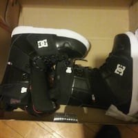 pair of black DC phase snowboard boots and helmet. Winnipeg, R3M 1B4