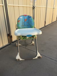 baby's white and blue high chair