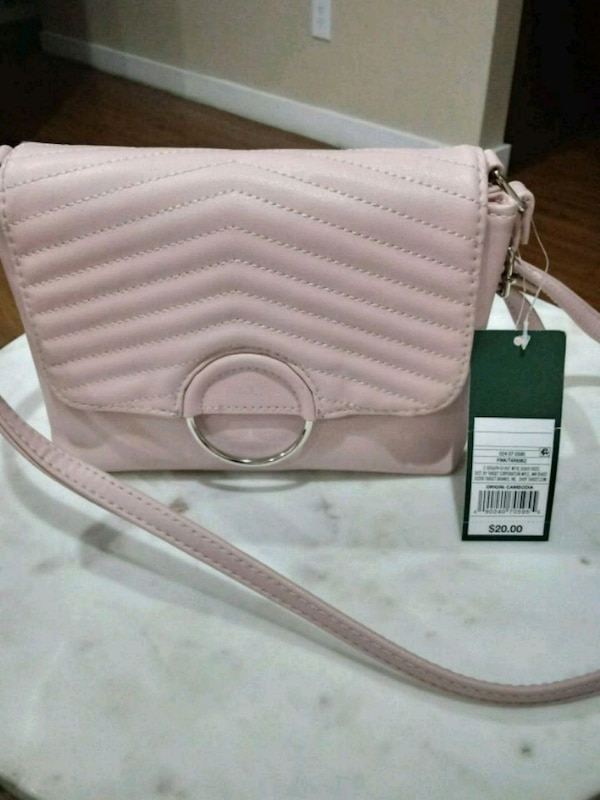 dd7eb16864d2 Used women s beige leather sling bag for sale in Princeton - letgo