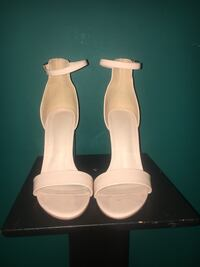 two white ceramic candle holders 48 km