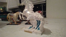 two white horse figurines