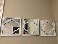 three square white wooden framed glass wall mirrors