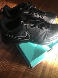 Black nike athletic shoes with box