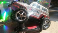 silver and red Predator radio-controlled car