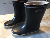 Pair of black tretorn winter boots