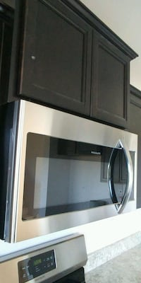 Frigidaire over the range microwave never used