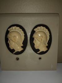 Vintage electrical Roman double switch cover.