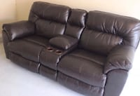 Ashleys leather espresso reclining sofa with storage under hand rest 38 km