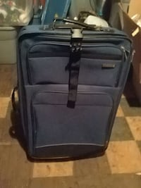 blue and black luggage bag