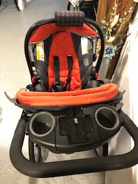 Stroller with carrier and base