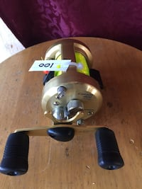 gray and black Catale 401 fishing reel