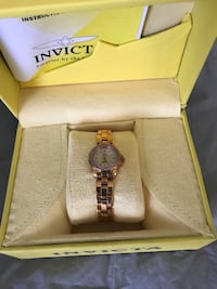 Ladies invicta watch with rubies