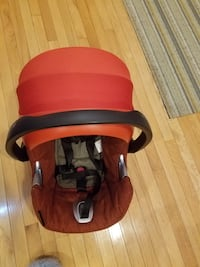 baby's red and black car seat carrier 56 km