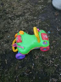green, red, and yellow Playskool ride-on toy