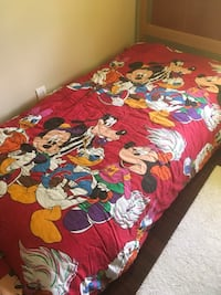 Mickey Mouse reversible twin bed spread.