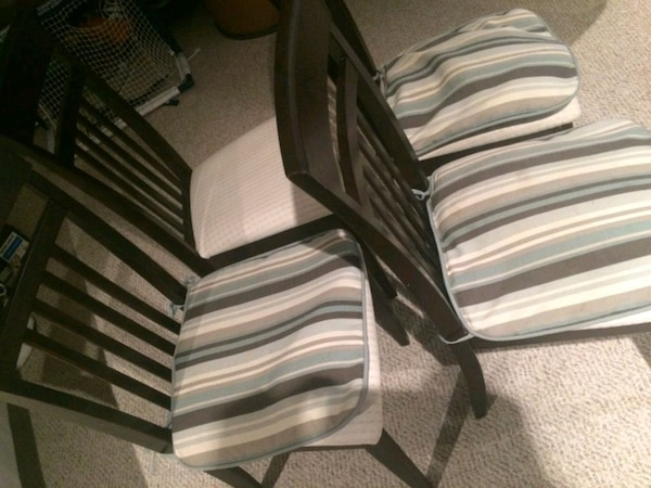 white and black striped fabric padded armchair