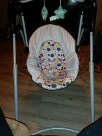 baby's white and blue swing chair Houston, 77009
