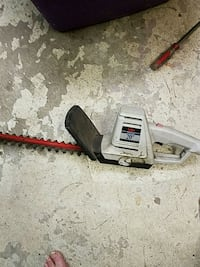 gray and red hedge trimmer Omaha