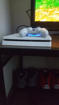 white Sony PS4 console with controller