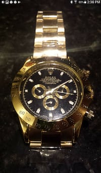 round gold-colored chronograph watch with link bracelet null