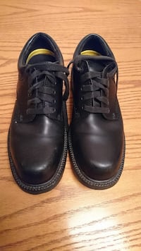 men's pair of black laced-up shoes