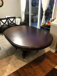 round brown wooden dining table