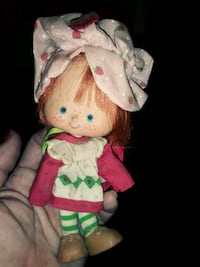 white and pink dressed female doll 68 km