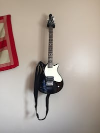 Black and white electric guitar and mini amp Calgary, T1Y 4L1