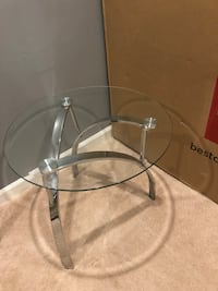 Round clear glass top coffee table with metal legs Bethesda, 20816
