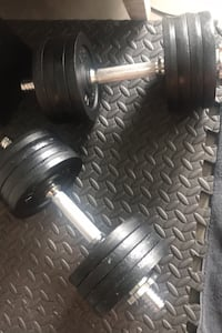 Good condition adjustable dumbell set up to 52 pounds each