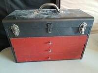 red and black wooden trunk chest with three drawers