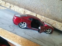 red and black coupe die-cast model Bay City, 48706
