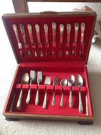 Set of 1847 Rogers Bros silverware with storage case