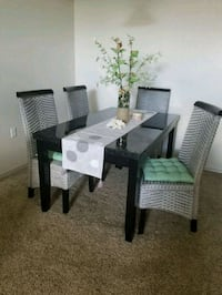 rectangular black wooden table with six chairs din El Paso, 79935