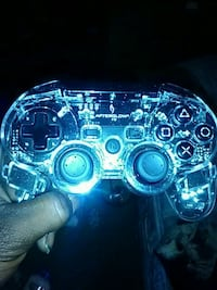 blue and black Sony PS3 controller
