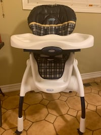 Baby's white and navy blue graco high chair Toronto, M6N 3P9
