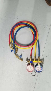 blue and red gauges with hoses