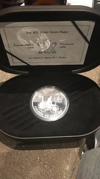round silver-colored 20 Canadian dollar coin