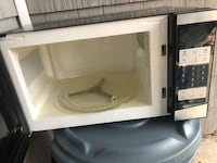 white and black microwave oven 274 mi