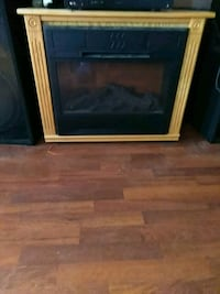 brown wooden fireplace comes with remote  Croswell, 48422