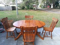 round brown wooden table with four chairs dining s Gulfport, 33707